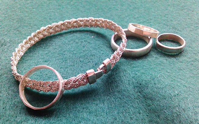 Examples of woven silver bracelet and ring designs in sterling silver.